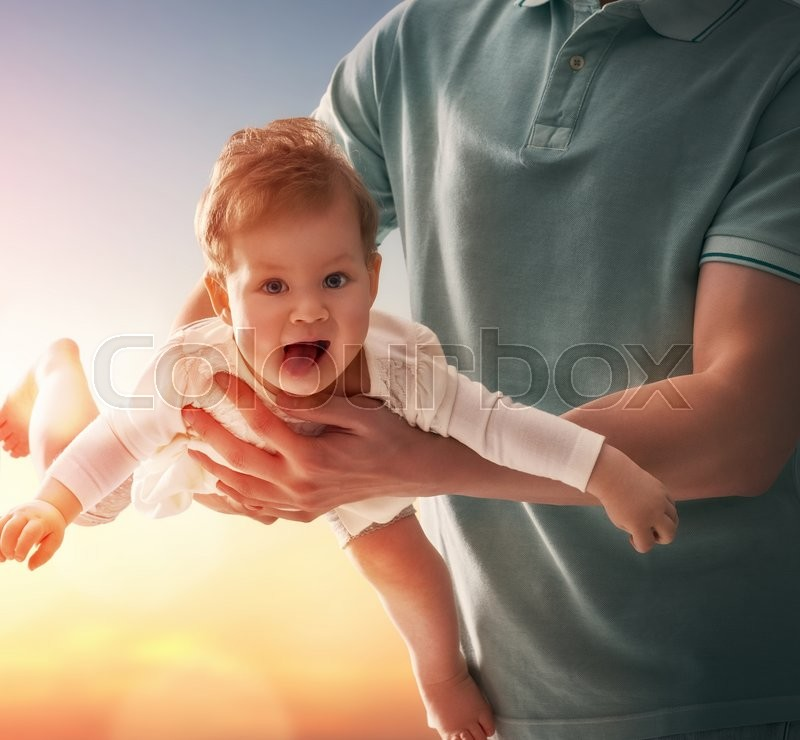 Happy loving family. Father and his daughter baby girl playing and hugging outdoors. Concept of Father\'s day, stock photo
