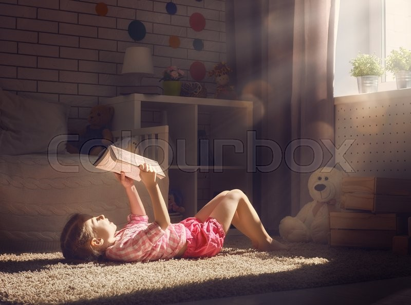 Stock image of 'Cute little child girl reading a book.'