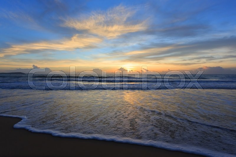Stock image of 'Sunrise sky in the morning with colorful cloud on the beach, beautiful summer background'