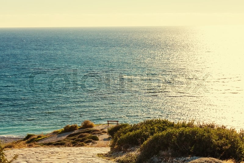 Stock image of 'Bench on the sea coast'