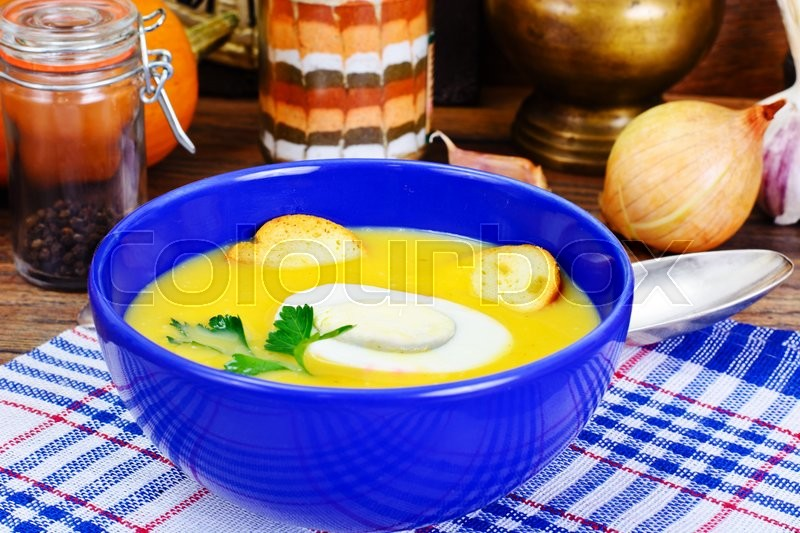 Stock image of 'Carrot, Pumpkin Cream Soup Diet Food. Studio Photo'