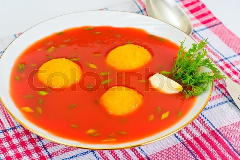 Stock image of 'Tomato Soup with Peppers Spicy, Cheese Balls, Garlic and Parsley Studio Photo'