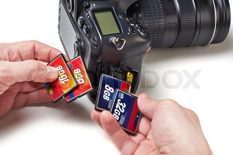 Stock image of 'Flash cards CF and DSLR camera close-up'