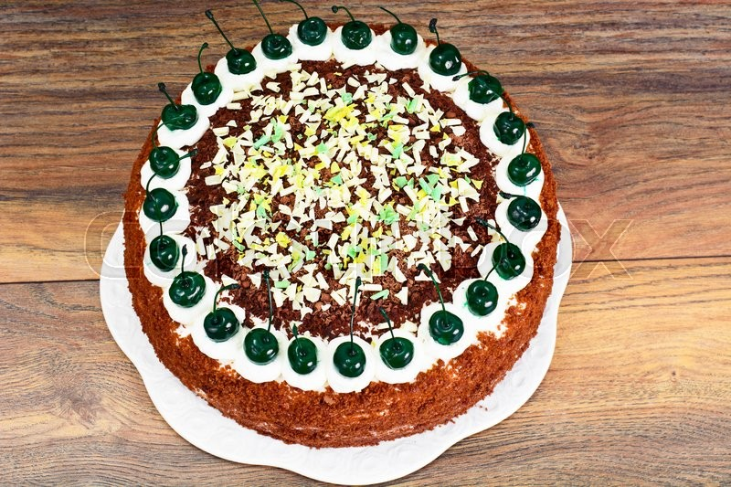 Stock image of 'Schwarzwald Cake, Whipped Cream, Black and White Chocolate, Decoration, Green Cocktail Cherry Studio Photo'