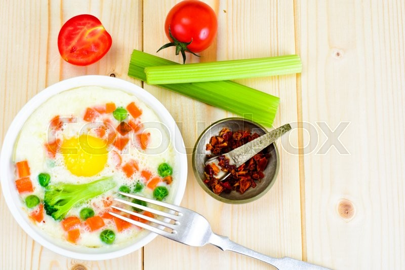 Stock image of 'Healthy and Diet Food: Scrambled Eggs with Vegetables. Studio Photo'