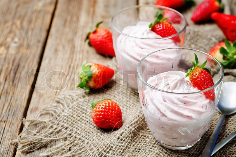 Stock image of 'strawberry mousse on a dark wooden background. toning. selective focus'