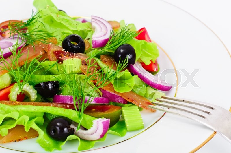 Stock image of 'Lettuce with tomato Kumata, Dried Meat, Celery and Olives Studio Photo'