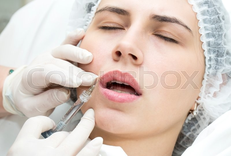 Stock image of 'young girl in a clinic contour lips procedure'