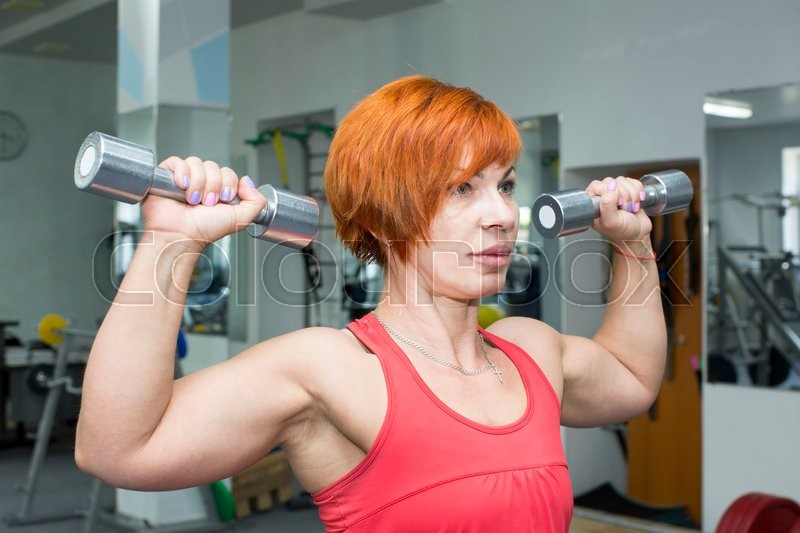 Stock image of 'adult female bodybuilding competitions in the gym'