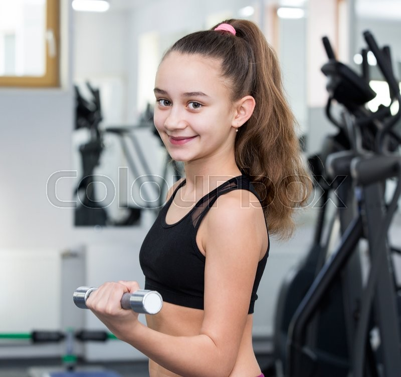Stock image of 'Girl is engaged in sports and gymnastics in the gym'