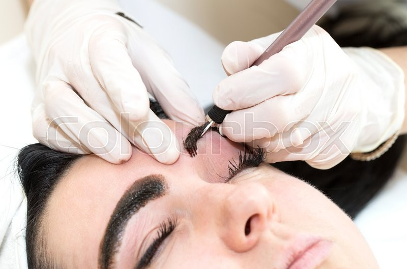 Stock image of 'Mikrobleyding eyebrows workflow in a beauty salon'