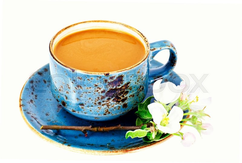 Stock image of 'Coffee  in a blue retro cup with Flowers. Studio Photo'