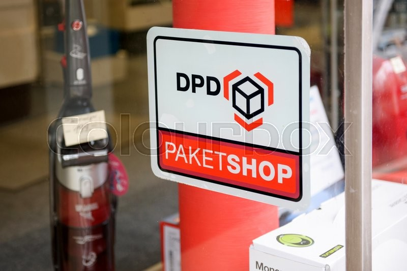 Editorial image of 'BADEN-BADEN, GERMANY - NOV 20, 2014: DPD Paket Shop logo on the entrance of a shop offering pick-up service for online orders. DPD is an international parcel delivery company owned by GeoPost La Poste France'