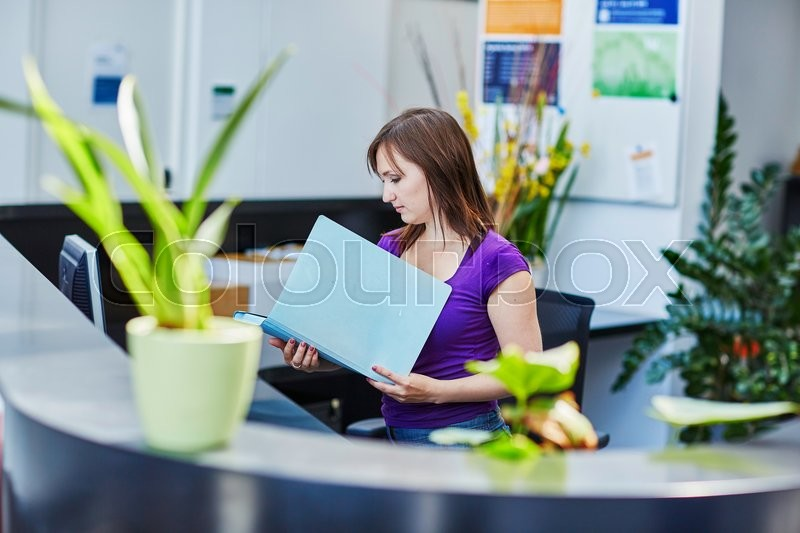 Stock image of 'Business, communication and call center concept - beautiful young receptionist at work'