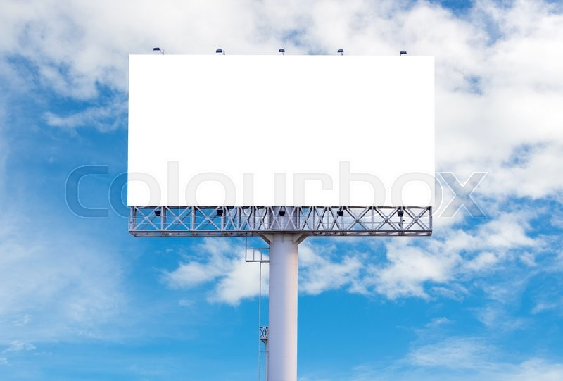 Stock image of 'Blank billboard ready for new advertisement with blue sky background.'