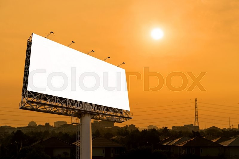 Stock image of 'Blank billboard for advertisement with sunset in city.'
