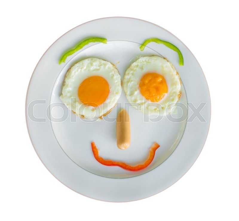 Stock image of 'Happy Face Frying Eggs for breakfast isolate on white.'
