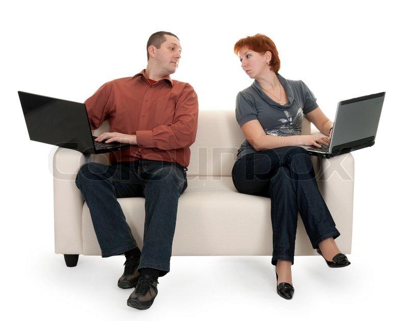 mann und frau auf der couch sitzen mit laptops stock foto colourbox. Black Bedroom Furniture Sets. Home Design Ideas