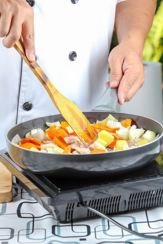 Stock image of 'chef cooking for fried vegetable in kitchen outdoor'