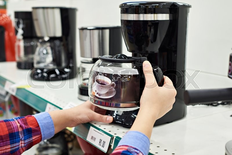 Buyer chooses the coffee machine in the store, stock photo