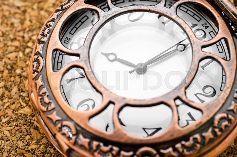 Stock image of 'Vintage pocket watch on wood table.'