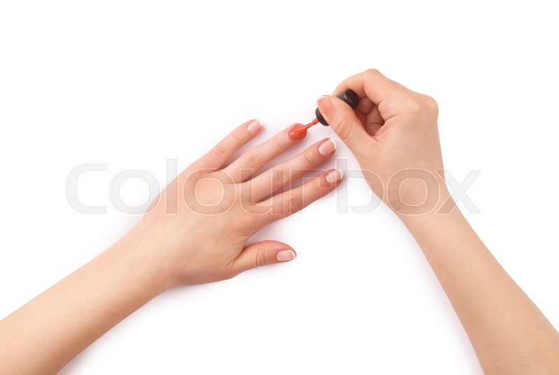 Stock image of 'woman paints her nails on white '