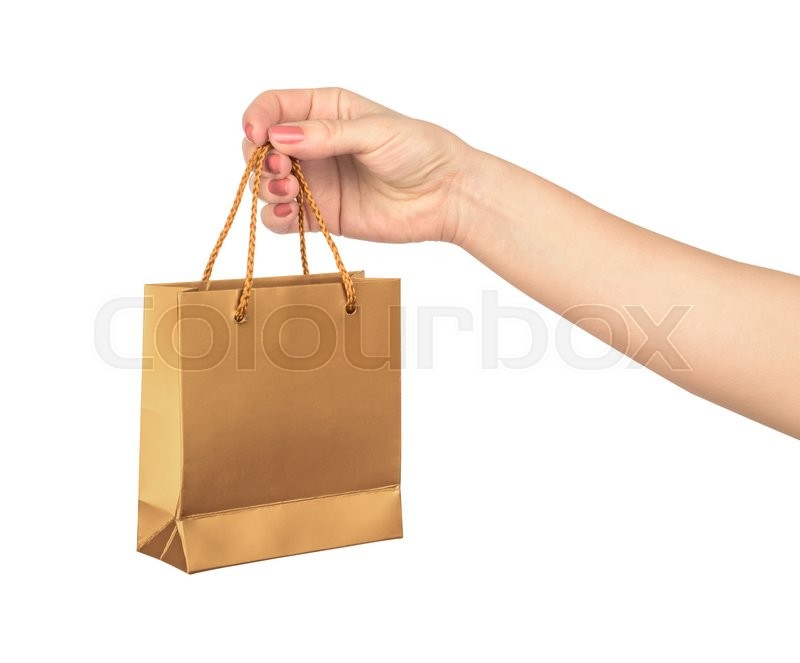 Stock image of 'Female hand hold a gold gift bag isolated on white background'