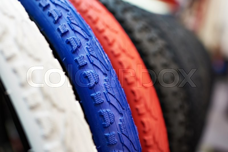 Stock image of 'New bicycle tires with different color tread close-up'