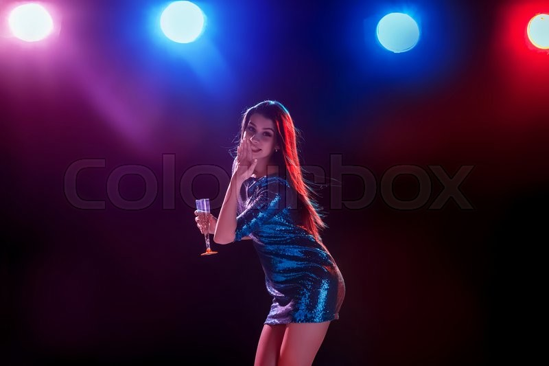 Stock image of 'Party, holidays, celebration, nightlife and people concept - smiling young beautiful girl dancing in club'