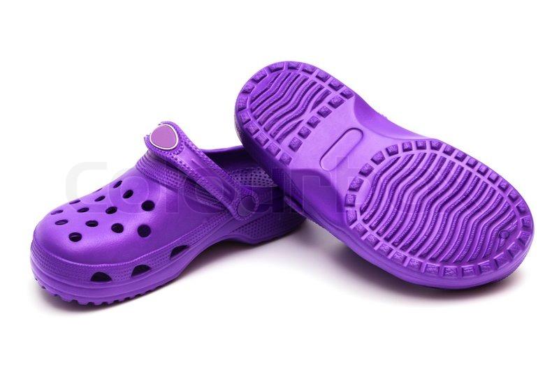 6063547653f0 Lilla gummi sko på en hvid baggrund