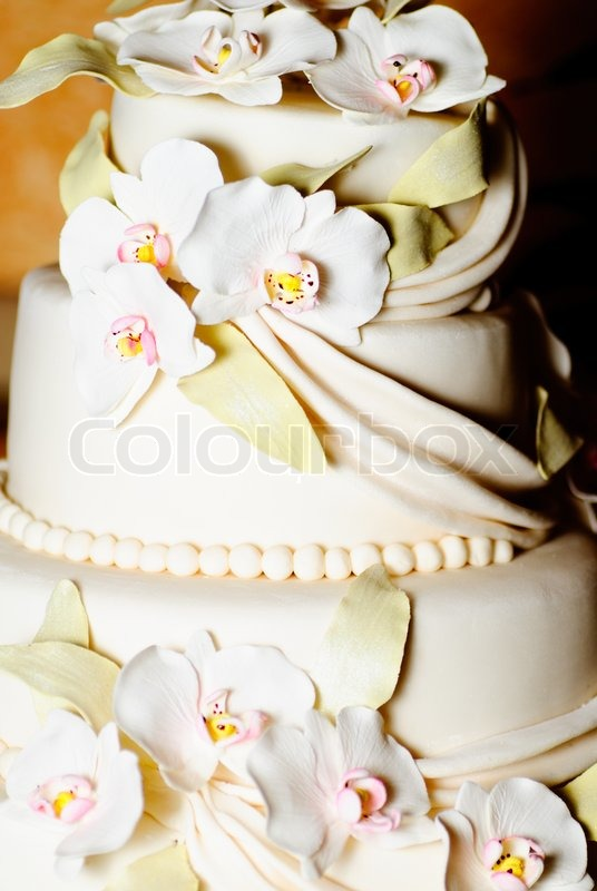 wedding cakes with icing wedding cake with white icing and orchids stock photo 26042