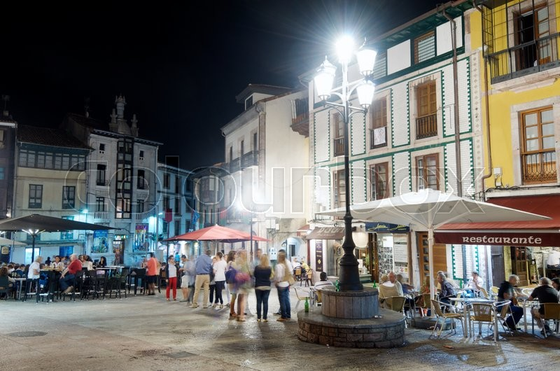 Editorial image of 'LLANES, SPAIN - AUGUST 19: Night on August 19, 2011 in Llanes: people eating dinner and having drinks in Llanes.'