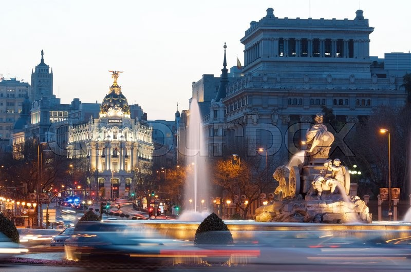 Editorial image of 'MADRID, SPAIN - MARCH 22: Madrid on March 22, 2012 in Madrid: heavy traffic in the historic center of Madrid, highlights the Metropolis building and the Cibeles fountain.'