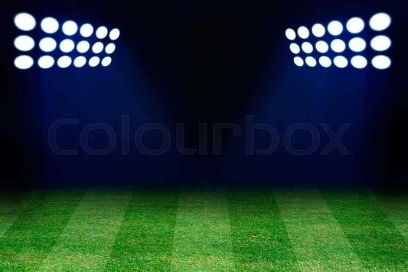 Stock image of 'Two spotlights on football grass field. Empty place for text or product'