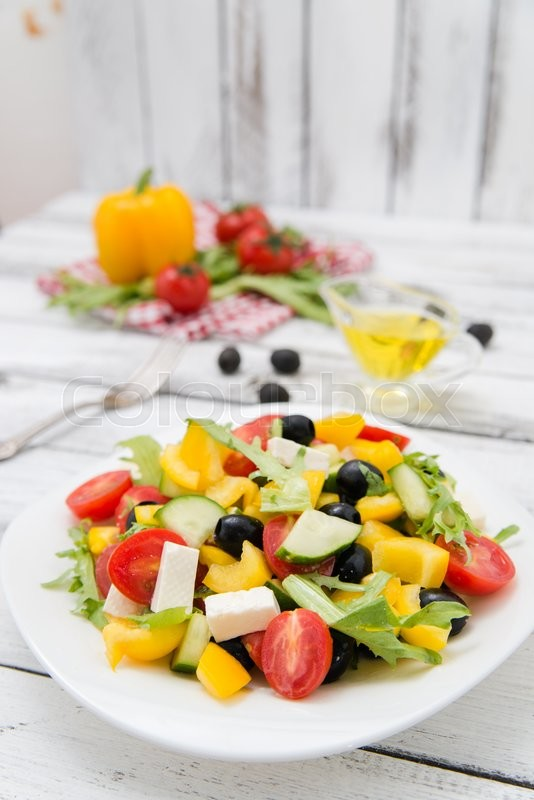 Stock image of 'Greek salad on wooden background close up'