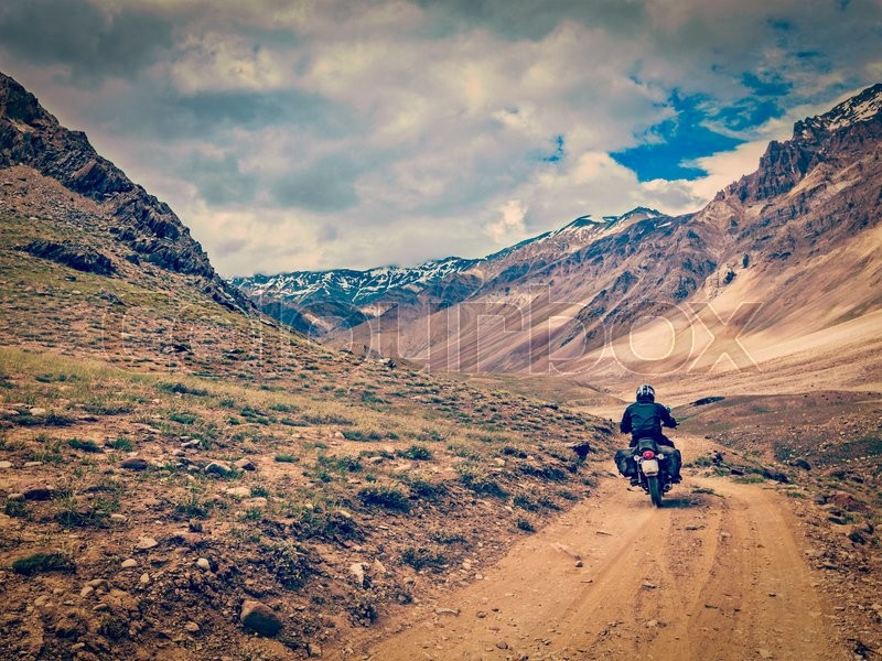 Stock image of 'Vintage retro effect filtered hipster style image of motorcycle bike on mountain road in Himalayas. Spiti Valley, Himachal Pradesh, India'
