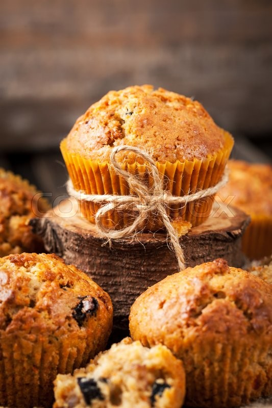 Stock image of 'Fresh homemade delicious carrot muffins with dried friuts  and nuts\'