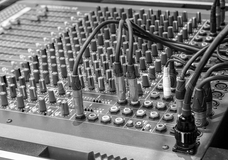 Black and white studio radio mixing. Audio music mixer. Digital sound equipment. Professional equalizer for concert mix, volume control, electronic instrument. Broadcast switch. Record technology, stock photo