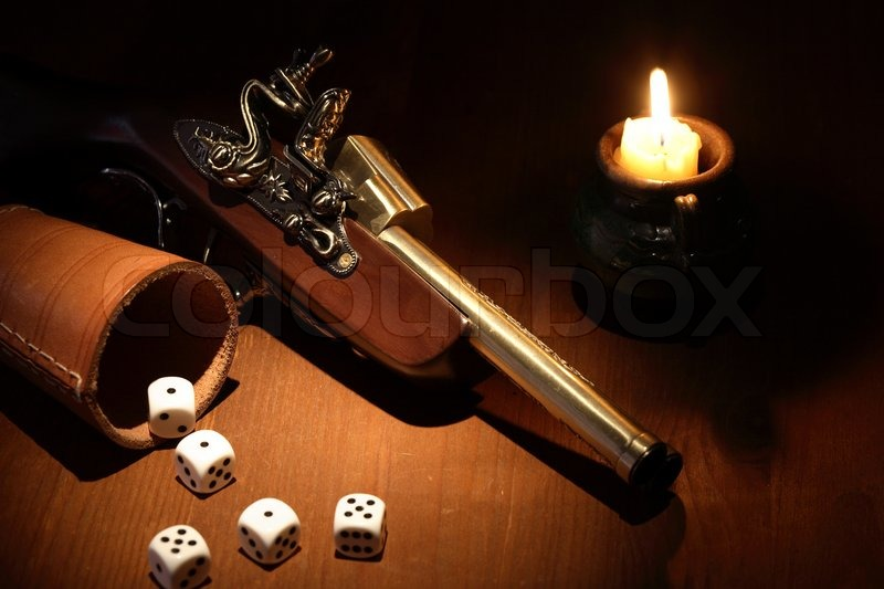 Vintage still life with old pistol and       Stock image   Colourbox