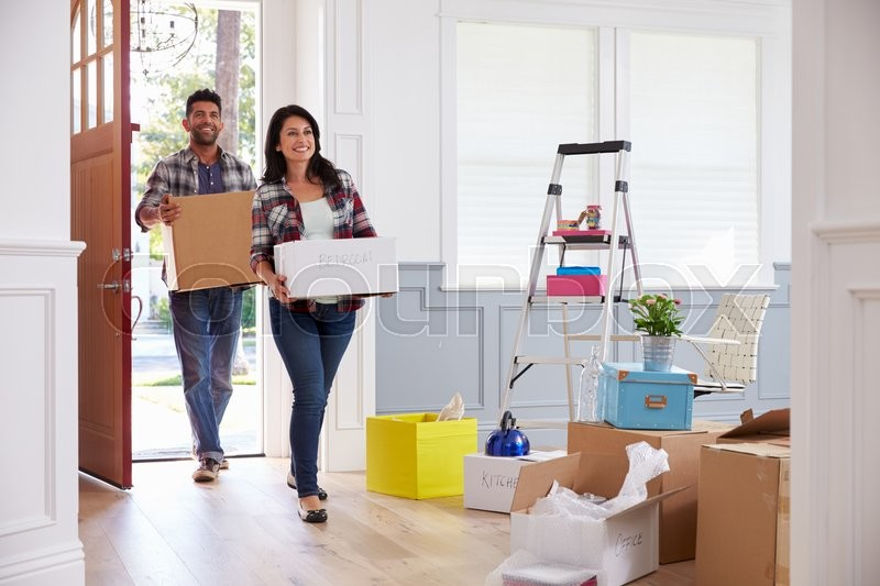 Hispanic Couple Moving Into New Home Together, stock photo