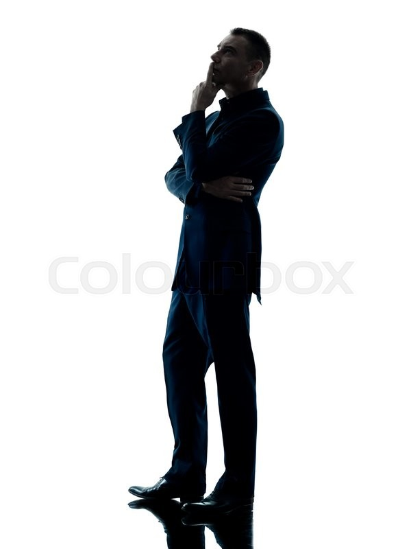 One caucasian business man standing thinking silhouette ...