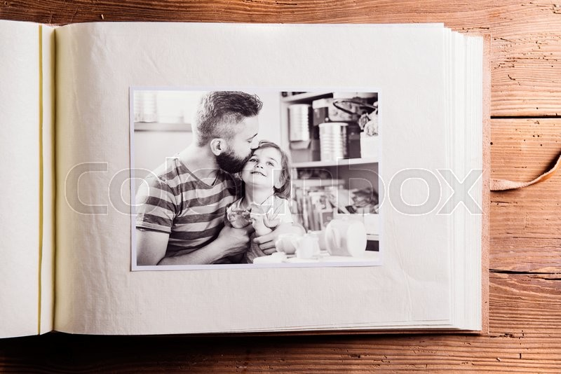 Fathers day composition. Photo album, black-and-white picture. Studio shot on wooden background, stock photo