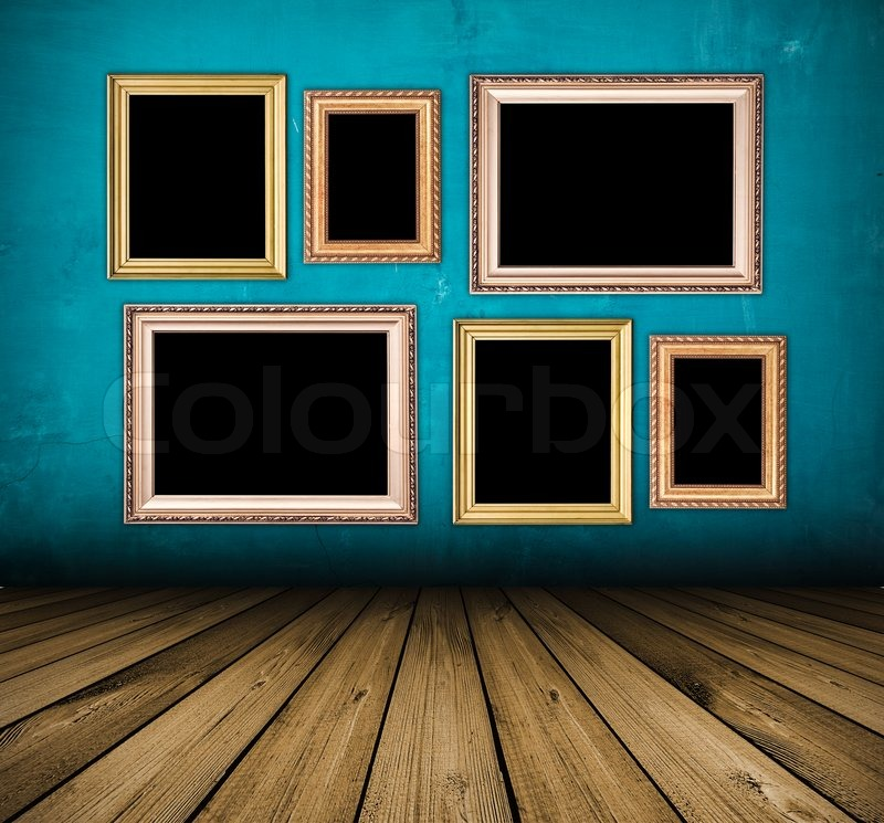 Vintage Blue Interior With Empty Frames Hanging On The Wall Stock Photo Colourbox