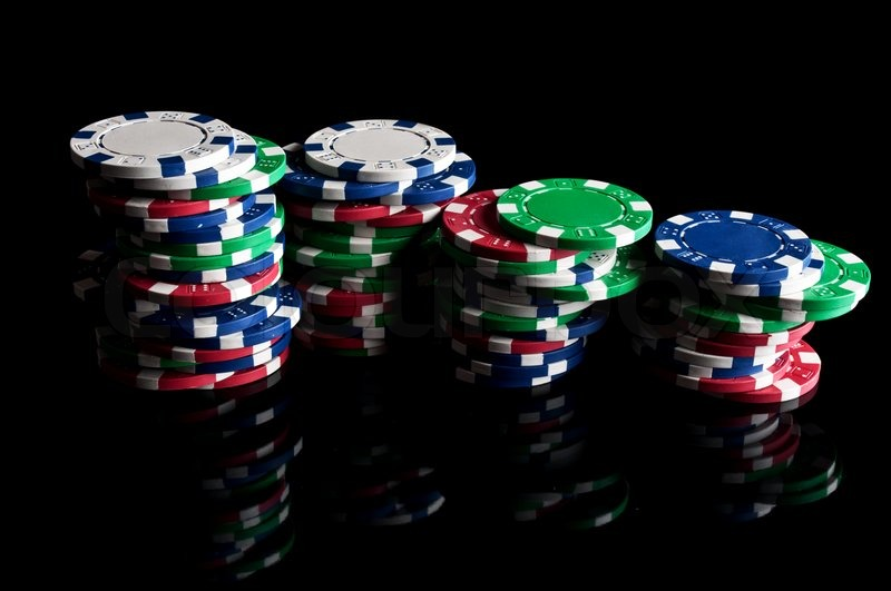 Many poker chips on a black background | Stock image | Colourbox