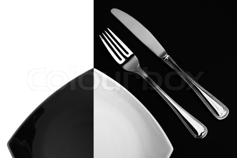 Knife Square White Plate And Fork On Black Background