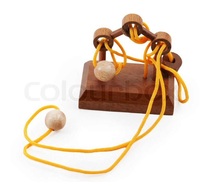 Wooden puzzle with a yellow rope and balls   Stock Photo ...