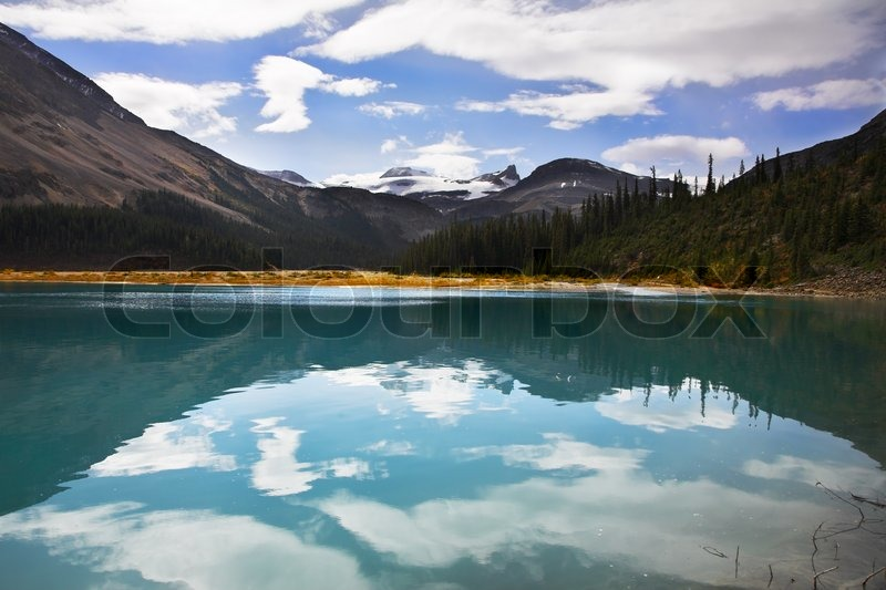 Silent mountain lake with the pure water surrounded by mountains stock photo colourbox - Impressive house with tranquil environment to get total relaxation ...