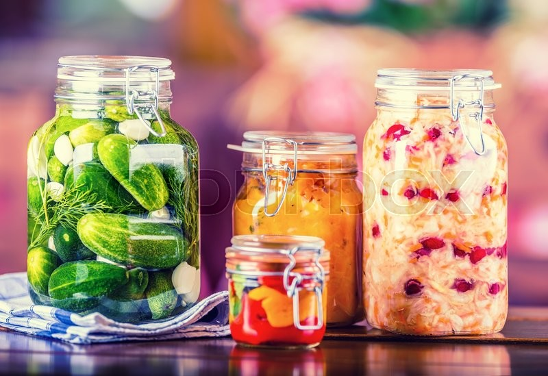 Preserving. Pickles jars. Jars with pickles, pumpkin dip, white cabbage, roasted red yellow pepper. Pickled Vegetables. Vegetable being prepared for preserving. Toned image, stock photo