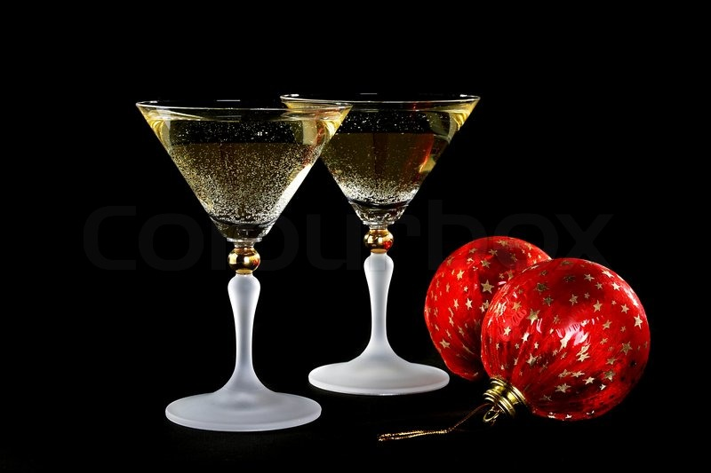 Two Glasses Of Champagne And Christmas Balls On A Black