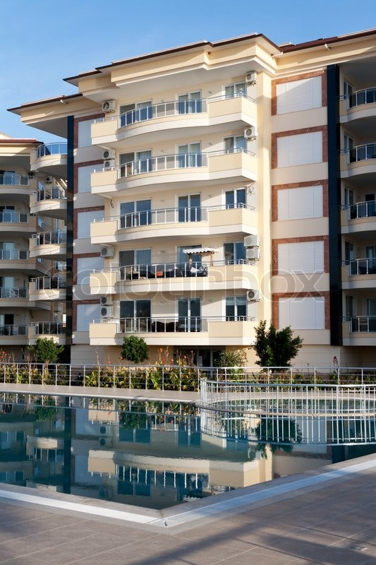 Beautiful house with balconies and a pool stock photo - Beautiful houses with balcony ...